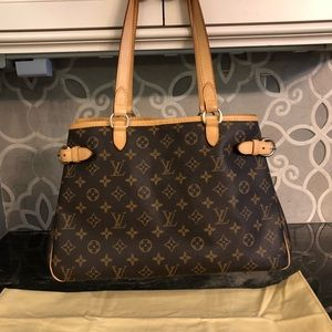 as good as brand new Louis Vuitton tote.